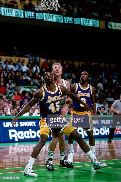 Larry Bird of the Boston Celtics battles for position against AC Green of the Los Angeles Lakers during a game in 1992 at the Boston Garden in Boston...
