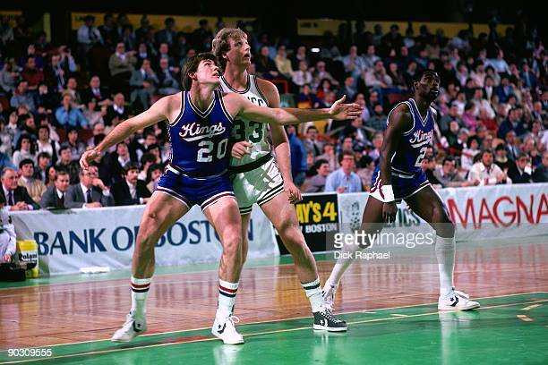 Larry Bird of the Boston Celtics battles for position against Ed Nealy of the Sacramento Kings during a game played in 1983 at the Boston Garden in...