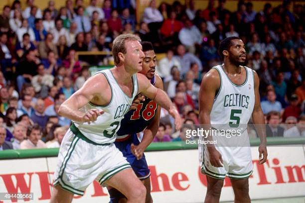 Larry Bird of the Boston Celtics battles for position against Hot Rod Williams of the Cleveland Cavaliers during a game played in 1992 at the Boston...