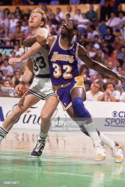Larry Bird of the Boston Celtics battles for position against Magic Johnson of the Los Angeles Lakers at the Boston Garden during the 1987 NBA Finals...