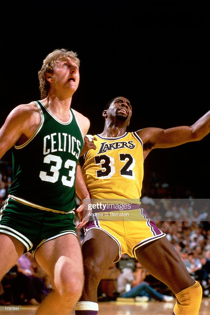 Larry Bird #33 of the Boston Celtics battles for rebound position with Magic Johnson of the Los Angeles Lakers during the NBA game at The Great Western Forum on January 1, 1986 in Los Angeles, California.