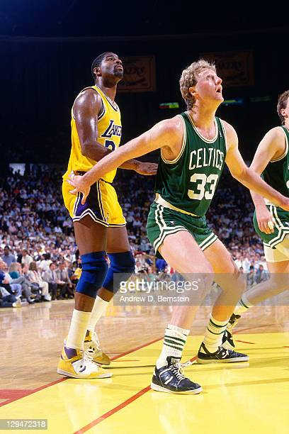 Larry Bird of the Boston Celtics boxes out against Magic Johnson of the Los Angeles Lakers circa 1987 at the Great Western Forum in Inglewood...