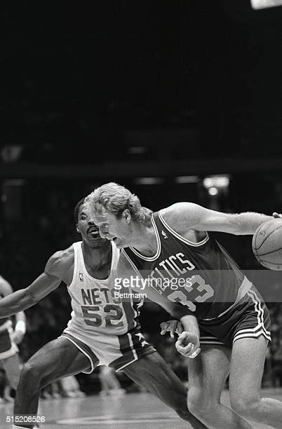 Larry Bird of the Boston Celtics breezes around Buck Williams of the New Jersey Nets during the fourth quarter action at Byrne Arena 1/13 The...