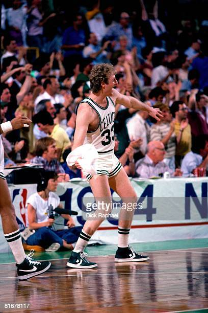 Larry Bird of the Boston Celtics celebrates during a game circa 1984 at the Boston Garden in Boston Massachusetts NOTE TO USER User expressly...