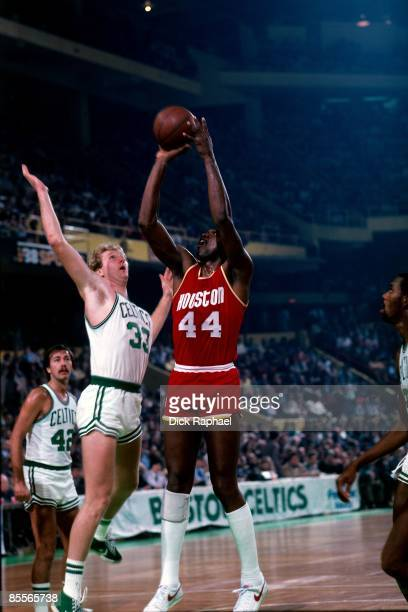Larry Bird of the Boston Celtics defends a shot by Elvin Hayes of the Houston Rockets during a game played in 1981 at the Boston Garden in Boston...
