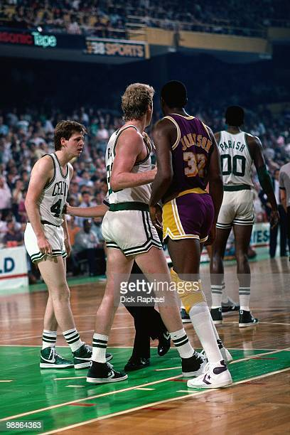 Larry Bird of the Boston Celtics defends against Magic Johnson of the Los Angeles Lakers during the 1985 NBA Finals at the Boston Garden in Boston...