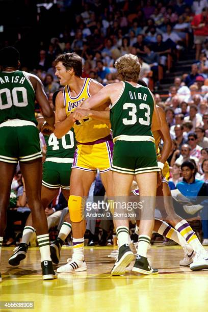 Larry Bird of the Boston Celtics defends against Swen Nater of the Los Angeles Lakers during a game in 1984 at the Great Western Forum in Los Angeles...