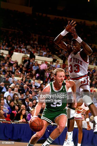 Larry Bird of the Boston Celtics dribbles to the basket against Patrick Ewing of the New York Knicks during a game circa 1990 at Madison Square...