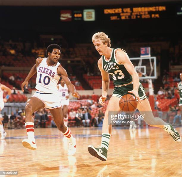 Larry Bird of the Boston Celtics dribbles upcourt against Maurice Cheeks of the Philadelphia 76ers circa the late 1970's during a game