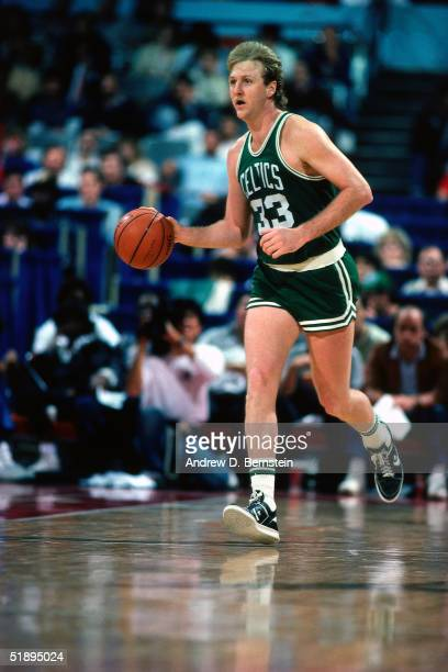 Larry Bird of the Boston Celtics dribbles upcourt during an NBA game in 1985 NOTE TO USER User expressly acknowledges and agrees that by downloading...