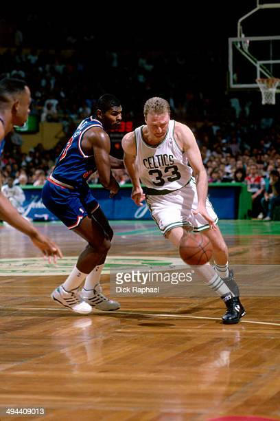 Larry Bird of the Boston Celtics drives against Hot Rod Williams of the Cleveland Cavaliers during a game played in 1992 at the Boston Garden in...