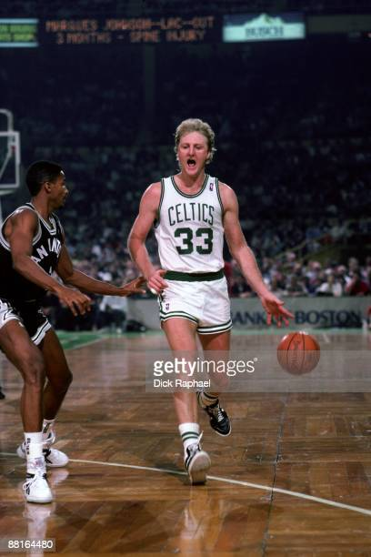 Larry Bird of the Boston Celtics drives the ball up court against the San Antonio Spurs during a game played in 1987 at the Boston Garden in Boston...