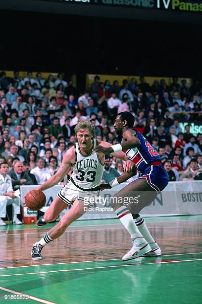 Larry Bird of the Boston Celtics drives to the basket against Charles Jones of the Washington Bullets during a game played in 1986 at the Boston...