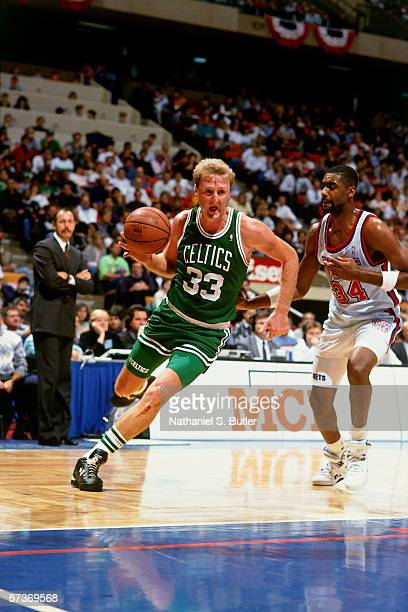 Larry Bird of the Boston Celtics drives to the basket against Chris Morris of the New Jersey Nets during a game circa 1990 at the Brendan Byrne Arena...