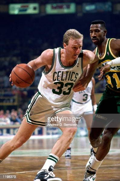Larry Bird of the Boston Celtics drives to the basket against the Seattle SuperSonics during an NBA game at the Boston Garden in Boston Massachusetts...