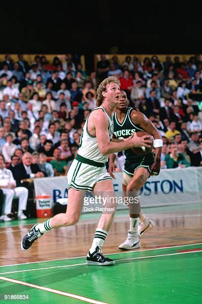 Larry Bird of the Boston Celtics drives to the basket against the Milwaukee Bucks during a game played in 1986 at the Boston Garden in Boston...