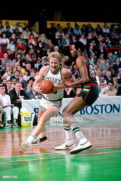 Larry Bird of the Boston Celtics drives to the basket against the Milwaukee Bucks during a game played in 1983 at the Boston Garden in Boston...