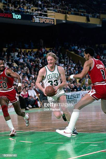 Larry Bird of the Boston Celtics drives to the basket during a game played against the Chicago Bulls circa 1986 at the Boston Garden in Boston...