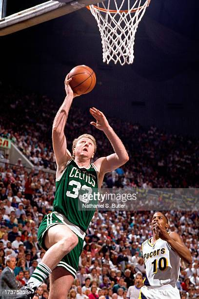 Larry Bird of the Boston Celtics drives to the basket for a layup during the NBA game against the Indiana Pacers on January 1 1990 in Indianapolis...