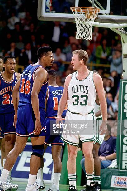 Larry Bird of the Boston Celtics exchanges words with John 'Hot Rod' WIlliams of the Cleveland Cavaliers during Game Three of the Eastern Conference...