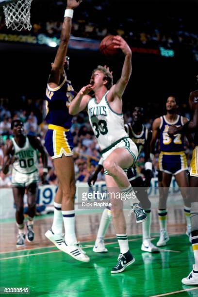 Larry Bird of the Boston Celtics goes up for a shot against Kareem Abdul Jabbar of the Los Angeles Lakers during Game Seven of the 1984 NBA Finals...