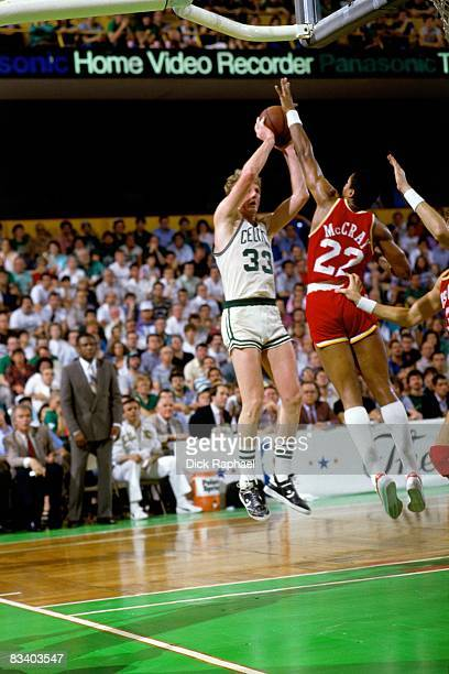 Larry Bird of the Boston Celtics goes up for a shot against Rodney McCray of the Houston Rockets during Game Six of the 1986 NBA Finals played on...
