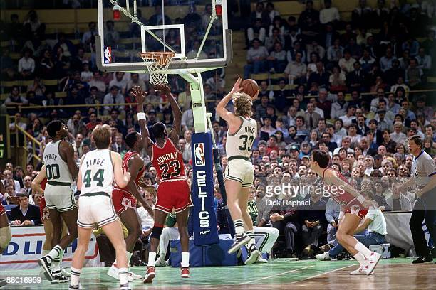 Larry Bird of the Boston Celtics goes up for a shot against the Chicago Bulls during an NBA game played in 1986 at the Boston Garden in Boston...