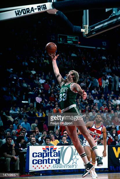 Larry Bird of the Boston Celtics grabs a rebound against the Washington Bullets during an NBA basketball game circa 1985 at the Capital Center in...