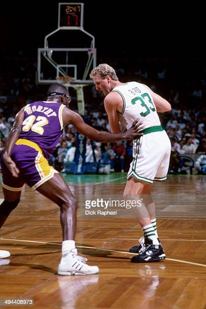 Larry Bird of the Boston Celtics handles the ball against James Worthy of the Los Angeles Lakers during a game played in 1992 at the Boston Garden in...