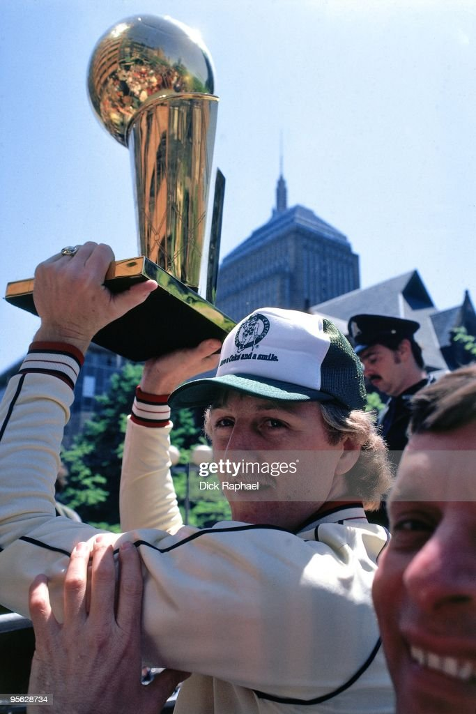 Larry Bird of the Boston Celtics holds the championship trophy over his head during their 1981 Championship parade in Boston Massachusetts NOTE TO...