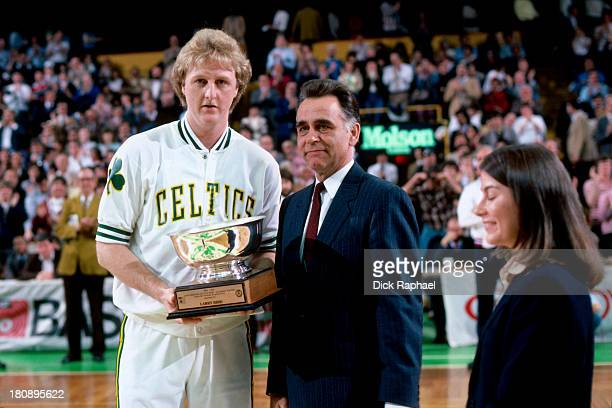 Larry Bird of the Boston Celtics is awarded the trophy for Most Valuable Player of the Boston Celtics an honor voted on by the New England press...