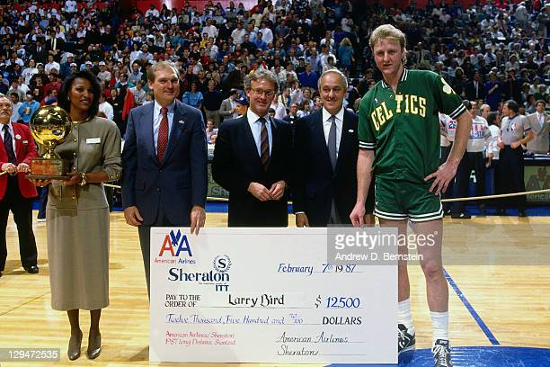 Larry Bird of the Boston Celtics is presented a check after winning the 1987 Three Point Contest as part of the 1987 NBA All Star Weekend on February...