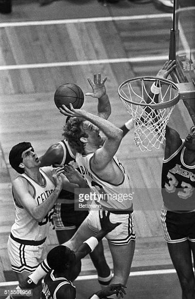 Larry Bird of the Boston Celtics' is pushed from behind as he goes up for the basket as the Lakers' Kareem Abdul Jabbar tries to stop him Pushing...