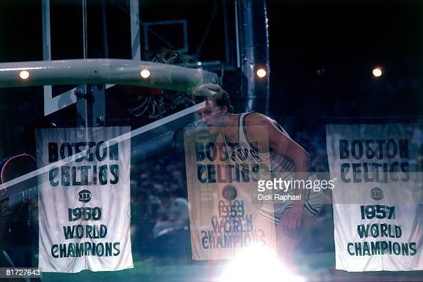 Larry Bird of the Boston Celtics is shown along side the Celtics Championship banners that hang at the Boston Garden circa 1982 in Boston...