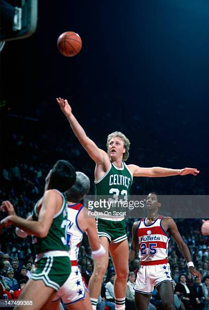 Larry Bird of the Boston Celtics lays the ball up against the Washington Bullets during an NBA basketball game circa 1985 at the Capital Center in...