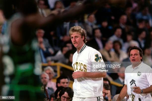 Larry Bird of the Boston Celtics looks on from sideline during an NBA game played in 1986 at the Boston Garden in Boston Massachusetts NOTE TO USER...