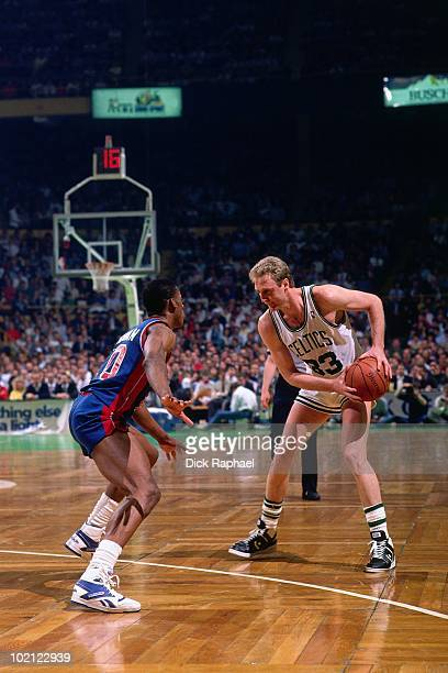 Larry Bird of the Boston Celtics looks to make a move against Dennis Rodman of the Detroit Pistons during a game played in 1987 at the Boston Garden...