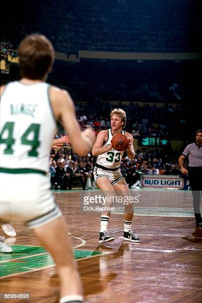 Larry Bird of the Boston Celtics looks to move the ball during a game played in 1983 at the Boston Garden in Boston Massachusetts NOTE TO USER User...