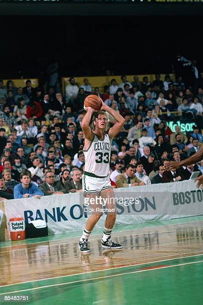 Larry Bird of the Boston Celtics looks to shoot during a game played in 1987 at the Boston Garden in Boston Massachusetts NOTE TO USER User expressly...
