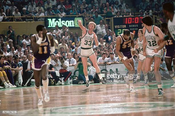 Larry Bird of the Boston Celtics makes a courts length pass against the Los Angeles Lakers in Game Five of the 1984 NBA Finals played on June 8 1984...