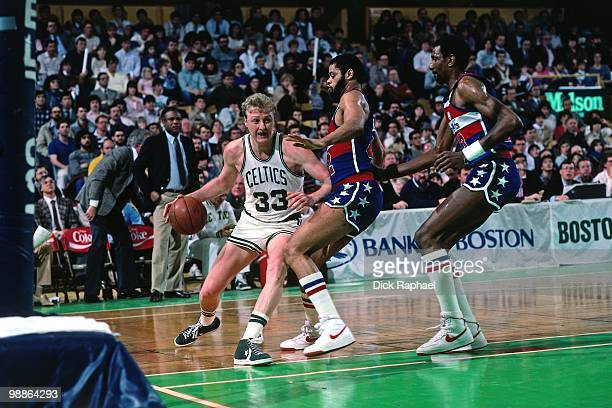 Larry Bird of the Boston Celtics makes a move to the basket against the Washington Bullets during a game played in 1985 at the Boston Garden in...
