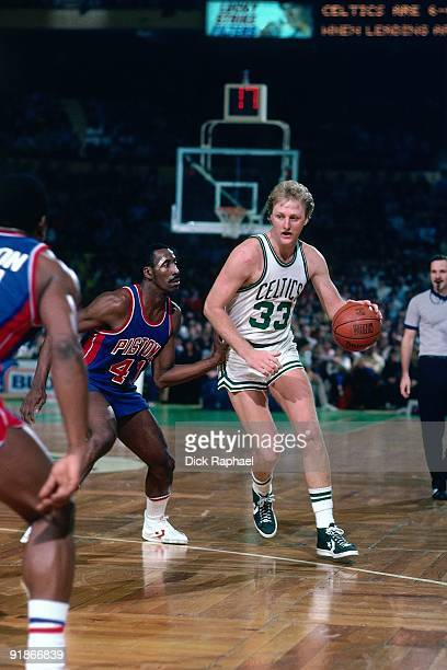 Larry Bird of the Boston Celtics moves the ball up court against the Detroit Pistons during a game played in 1986 at the Boston Garden in Boston...