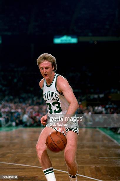 Larry Bird of the Boston Celtics moves the ball up court during a game played in 1984 at the Boston Garden in Boston Massachusetts NOTE TO USER User...
