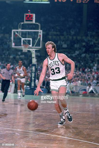 Larry Bird of the Boston Celtics moves the ball up court during a game played in 1986 at the Boston Garden in Boston Massachusetts NOTE TO USER User...