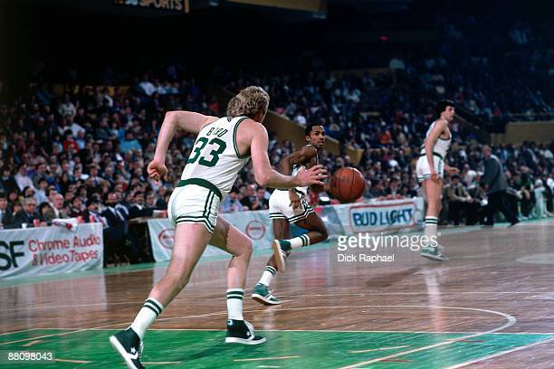 Larry Bird of the Boston Celtics moves the ball up on the break against the Dallas Mavericks during a game played in 1984 at the Boston Garden in...