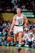 Larry Bird of the Boston Celtics moves the ball upcourt during the NBA game at the Boston Garden in Boston Masachussetts NOTE TO USER User expressly...