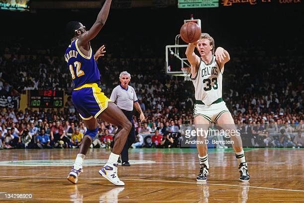 Larry Bird of the Boston Celtics passes against James Worthy of the Los Angeles Lakers circa 1987 at the Boston Garden in Boston Massachussetts NOTE...
