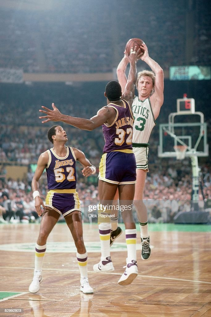 Larry Bird #33 of the Boston Celtics passes against Magic Johnson #32 of the Los Angeles Lakers in Game Five of the 1984 NBA Finals played on June 8, 1984 at Boston Garden in Boston, Massachusetts. Boston defeated Los Angeles 121-103.