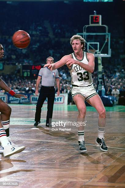 Larry Bird of the Boston Celtics passes during a game played in 1984 at the Boston Garden in Boston Massachusetts NOTE TO USER User expressly...
