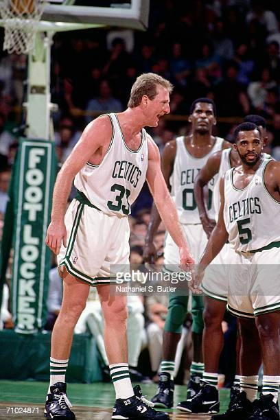 Larry Bird of the Boston Celtics points out directions to his teammates during a game played in 1992 at the Boston Garden in Boston Massachusetts...